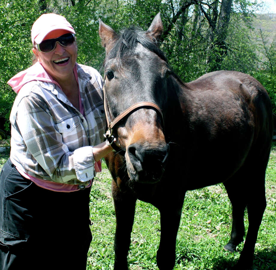 H.O.R.S.E. volunteer Darlene Lockwood and Wilbur smile for the camera recently in Washington. Wilbur is a registered standard-bred gelding who was a starvation case from Wethersfield. In August 2011, his girlfriend ìShiloh,î a 28-year-old Arabian mare, was euthanized. Wilbur has recovered to the best of his ability and can now carry a 100-pound rider.  Courtesy of H.O.R.S.E. Photo: Contributed Photo
