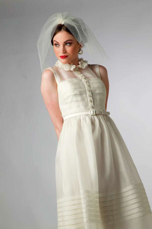 BHLDN offers bridal dresses in fresh, contemporary styles, at left and below. Photo: Mayra Beltran / © 2012 Houston Chronicle