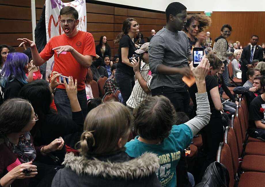 "Charlie Eaton (left) and Devonte Jackson (right) join other students dressed as zombies and dance to Michael Jackson's ""Thriller"" while disrupting the UC Board of Regents meeting to protest a proposal to raise fees for graduate students in San Francisco, Calif. on Wednesday, July 18, 2012. Photo: Paul Chinn, The Chronicle"