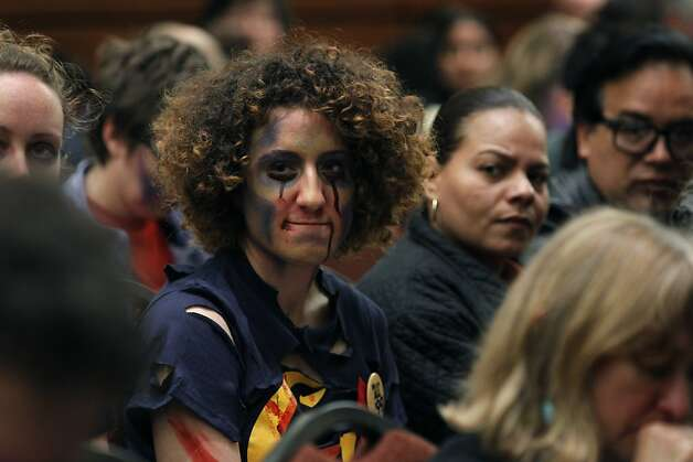 UC Berkeley student Ali Oligny listens to other students, many others dressed as zombies, speak out against a proposal to raise fees for graduate students during the UC Board of Regents meeting in San Francisco, Calif. on Wednesday, July 18, 2012 Photo: Paul Chinn, The Chronicle