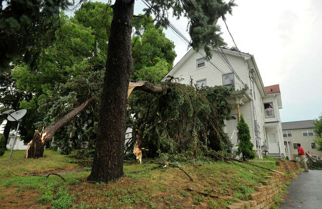 A tree and a large branch from another tree fell in the front lawn of a home on Coal Pit Hill Road in Danbury after a strong thunderstorm went through the city on Wednesday, July 18, 2012. Photo: Jason Rearick / The News-Times