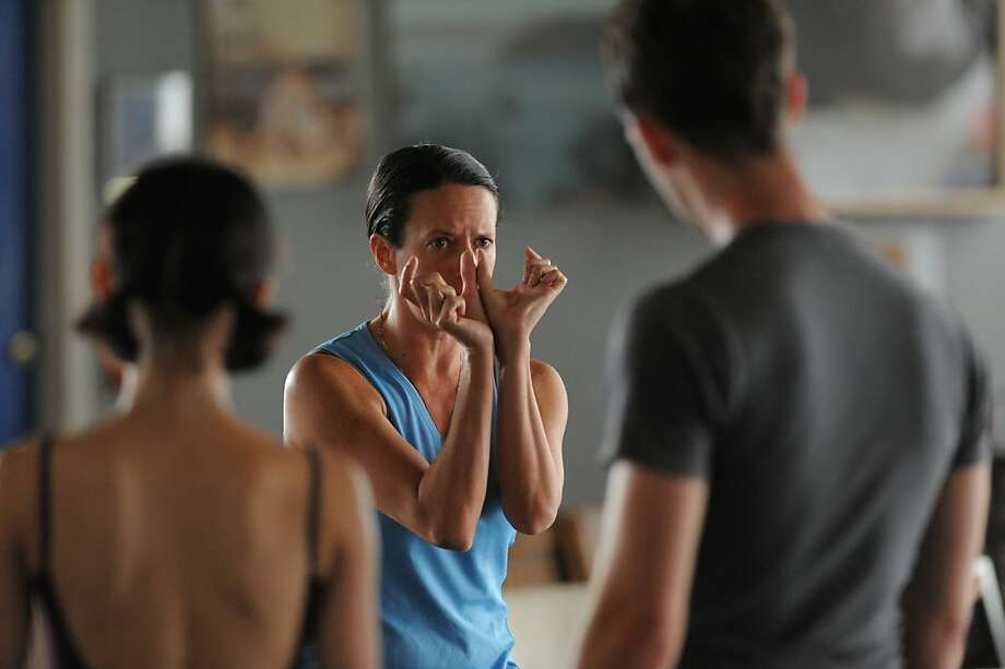 "Choreographer Amy Seiwert (in focus) and dancers: Peng-Yu Chen & Ben Needham-Wood at Zaccho Dance Theater creatibg  ""In the Time"" by Seiwert, which will premiere Aug. 2-4 at ODC Theater as part of ""Sketch 2: The Women Choreographers."" Photo: © Scot Goodman"