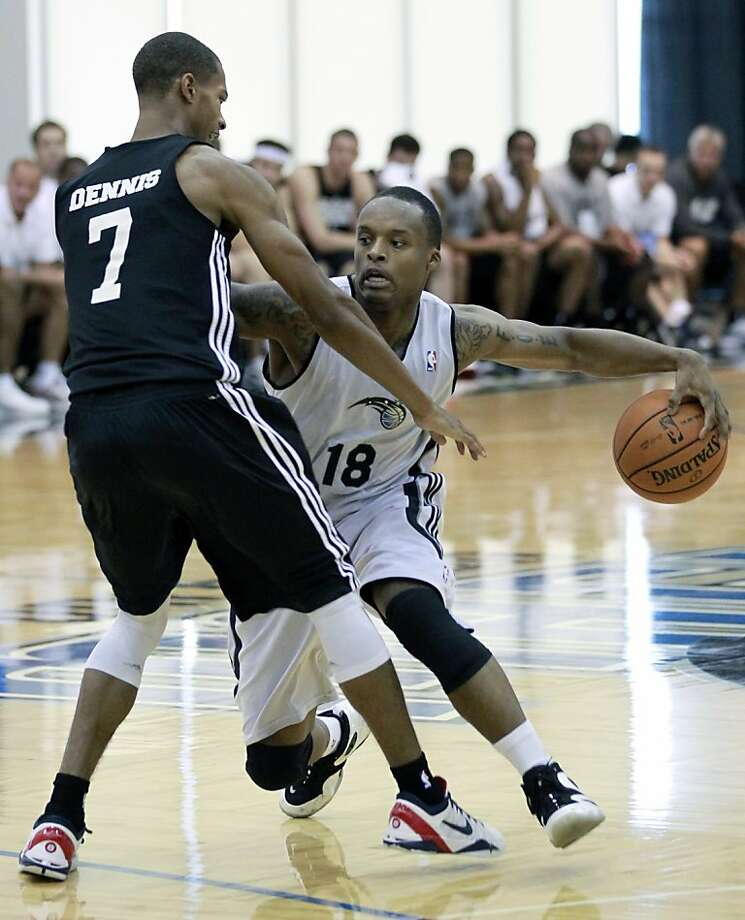 Orlando Magic's Maalik Wayns (18) drives against Brooklyn Nets' Stephen Dennis (7) during an NBA summer league basketball game, Monday, July 9, 2012, in Orlando, Fla. (AP Photo/John Raoux) Photo: John Raoux, Associated Press