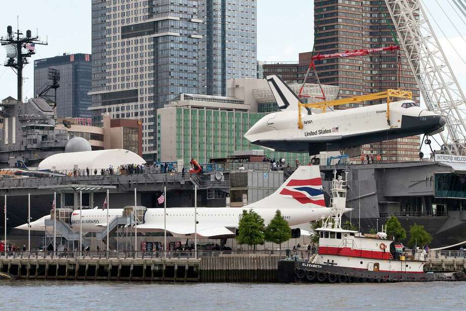 A former British Airways Concorde at the Intrepid Sea, Air and Space Museum, in New York, got a new neighbor on June 6, 2012, when the atmospheric test space shuttle Enterprise arrived. Photo: Andrew Burton, Getty Images