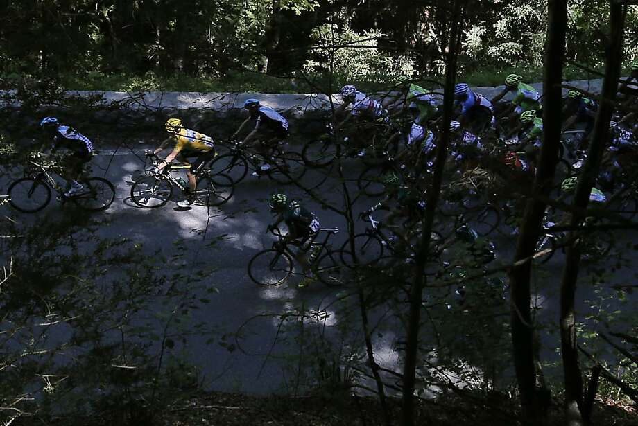 Bradley Wiggins of Britain, wearing the overall leader's yellow jersey. climbs  Aubisque pass during the 16th stage of the Tour de France cycling race over 197 kilometers (122.4 miles) with start in Pau and finish in Bagneres-de-Luchon, France, Wednesday July 18, 2012. (AP Photo/Christophe Ena) Photo: Christophe Ena, Associated Press