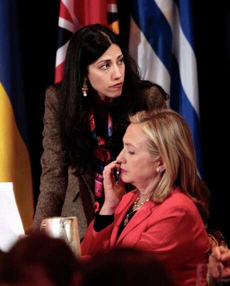 Huma Abedin, top, is deputy chief of staff to Secretary of State Hillary Rodham Clinton. Photo: Pablo Martinez Monsivais / AP