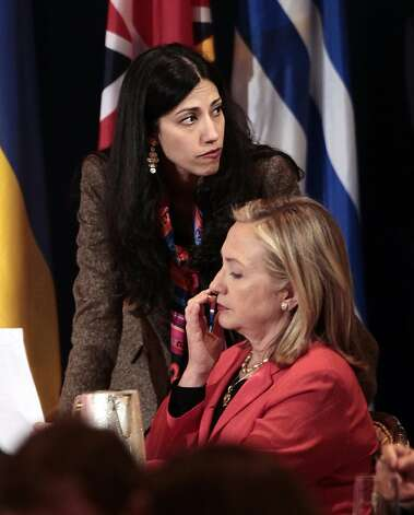 FILE - In this Sept. 20, 2011 file photo, Huma Abedin, top, deputy chief of staff and aide to Secretary of State Hillary Rodham Clinton, right, during a meeting with leaders for the Open Government Partnership in New York.    Republican Sen. John McCain is defending a longtime aide to Secretary of State Hillary Rodham Clinton against unsubstantiated allegations that her family has ties to Egypt's Muslim Brotherhood. (AP Photo/Pablo Martinez Monsivais) Photo: Pablo Martinez Monsivais, Associated Press