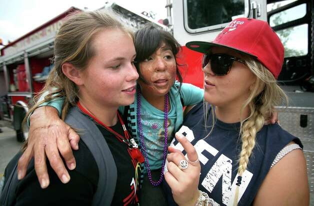 Counselors Margy Gorman, left, and Alice Gladwell, right, help burn survivor Karla Ovalle, 9, center, from San Antonio, down from a Kerrville Fire Department truck at Camp David.  Campers from all over Texas take part in the Texas Burn Survivor Society's Pediatric Burn Camp, called Camp David, held at Texas Lion's Camp in Kerrville, TX.  Wednesday, July 18, 2012. Photo: Bob Owen, San Antonio Express-News / © 2012 San Antonio Express-News