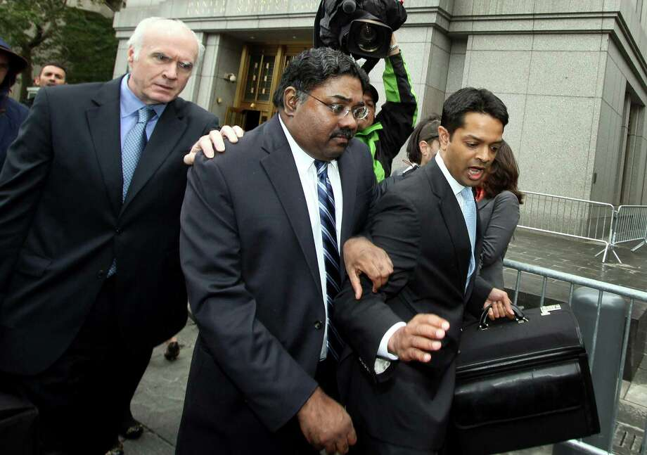 FILE PHOTO: Raj Rajaratnam, co-founder of Galleon Group LLC, center, exits federal court with his attorney Terence Lynam, left, in New York, U.S., on Thursday, Oct. 13, 2011. Rajaratnam, convicted of directing the biggest insider-trading ring in a generation, must go to prison while he challenges the government's use of wiretaps in his trial, an appeals court ruled. Rajaratnam is scheduled to begin an 11-year sentence at Federal Medical Center Devens in Ayer, Massachusetts, on Dec. 5. Photographer: Rick Maiman/Bloomberg *** Local Caption *** Raj Rajaratnam; Terence Lynam Photo: Rick Maiman, Bloomberg / © 2011 Bloomberg Finance LP
