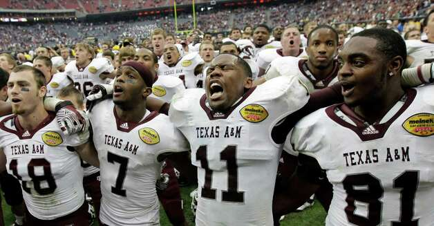 Texas A&M's Kyle Mangan (18), Uzoma Nwachukwu (7), Jonathan Stewart (11) and Nehemiah Hicks (81) celebrate after winning the Car Care Bowl NCAA college football game against Northwestern Saturday, Dec. 31, 2011, in Houston. Texas A&M defeated Northwestern 33-22. Photo: AP