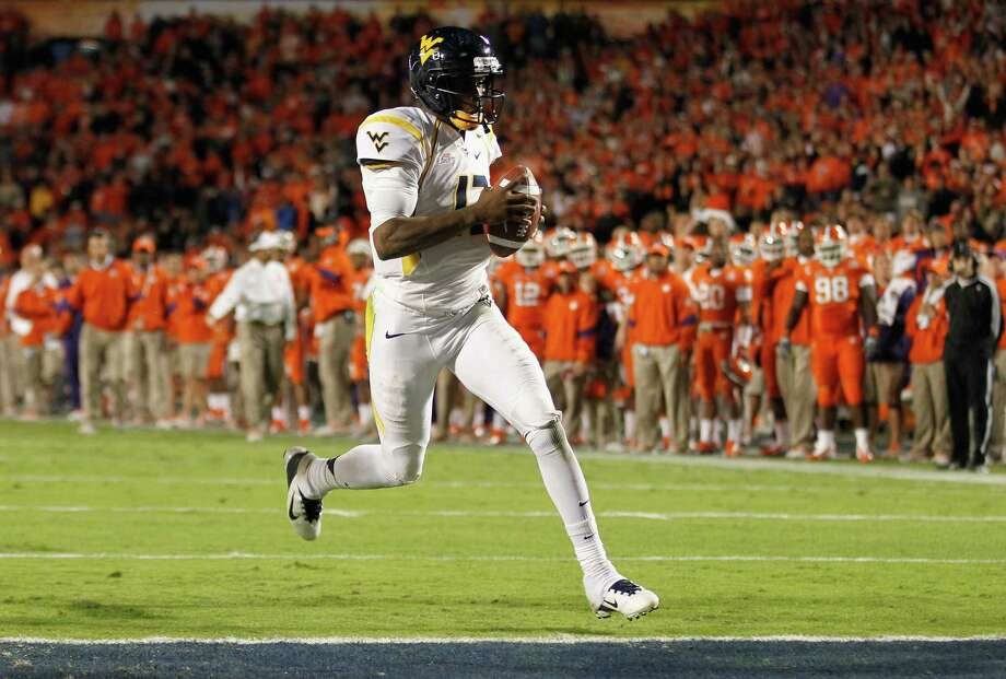 West Virginia quarterback Geno Smith was voted the Big 12's preseason Offensive Player of the Year by media members. Photo: Streeter Lecka, Getty Images / 2012 Getty Images