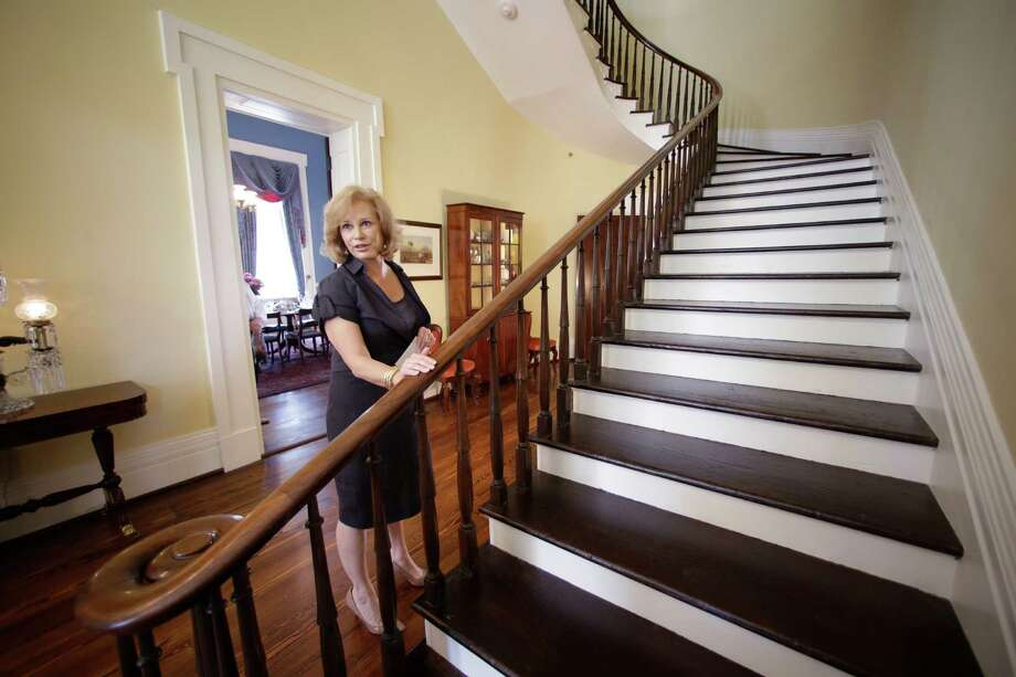 Texas first lady Anita Perry gives a tour of the Texas Governor's Mansion on Wednesday in Austin. After four years and a $25 million restoration project, the building that was nearly destroyed by fire is complete. Photo: Eric Gay / AP