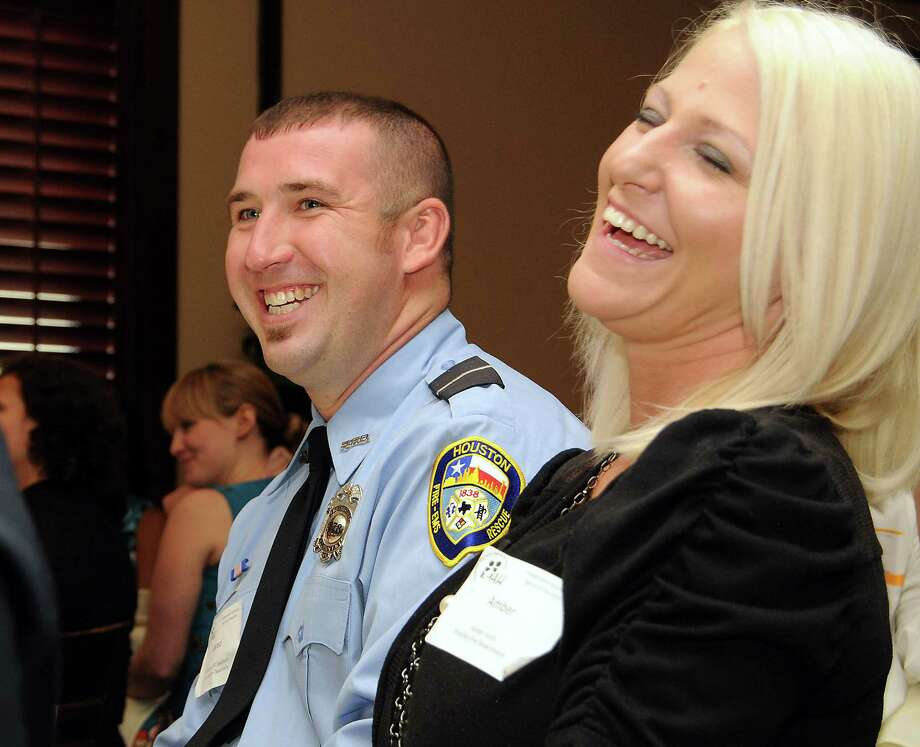 Houston firefighter-EMT Jared Keith and his wife Amber react Wednesday after it was announced that he  received the Firefighter of the Year award. He pulled a man from a burning truck and removed a pistol to protect his fellow firefighters. Photo: Dave Rossman / © 2012 Dave Rossman