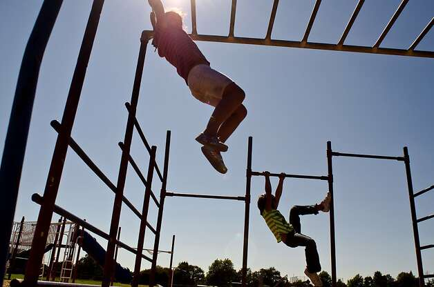 Children at James Monroe Elementary in Santa Rosa, California climb on worn, outdated playground equipment which require additional funds for replacement. Photo: Alvin Jornada, Special To The Chronicle