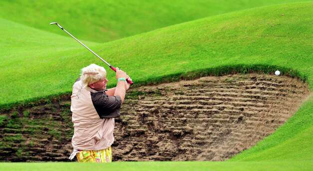 John Daly of the US chips from a bunker onto the 6th green during a practice round for the 2012 British Open Golf Championship at Royal Lytham & St Anne's in Lytham, north-west England, on July 18, 2012 ahead of the Open Championship which begins on July 19. AFP PHOTO / GLYN KIRKGLYN KIRK/AFP/GettyImages Photo: GLYN KIRK