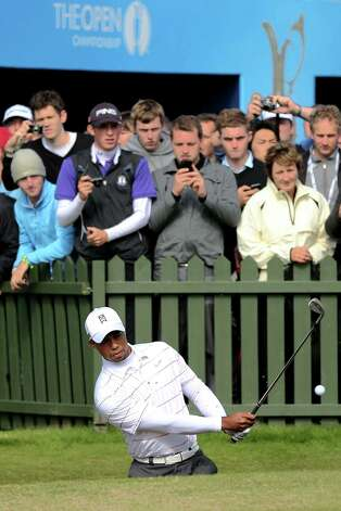 LYTHAM ST ANNES, ENGLAND - JULY 18:  Tiger Woods of the United States plays a bunker shot on the practice ground as fans look on during the third practice round prior to the start of the 141st Open Championship at Royal Lytham & St Annes on July 18, 2012 in Lytham St Annes, England.  (Photo by Richard Heathcote/Getty Images) Photo: Richard Heathcote