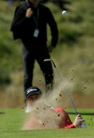 Morten Orum Madsen of Denmark plays out of a bunker during a practice round at Royal Lytham & St Annes golf club ahead of the British Open Golf Championship, Lytham St Annes, England, Wednesday, July 18, 2012. (AP Photo/Jon Super) Photo: Jon Super