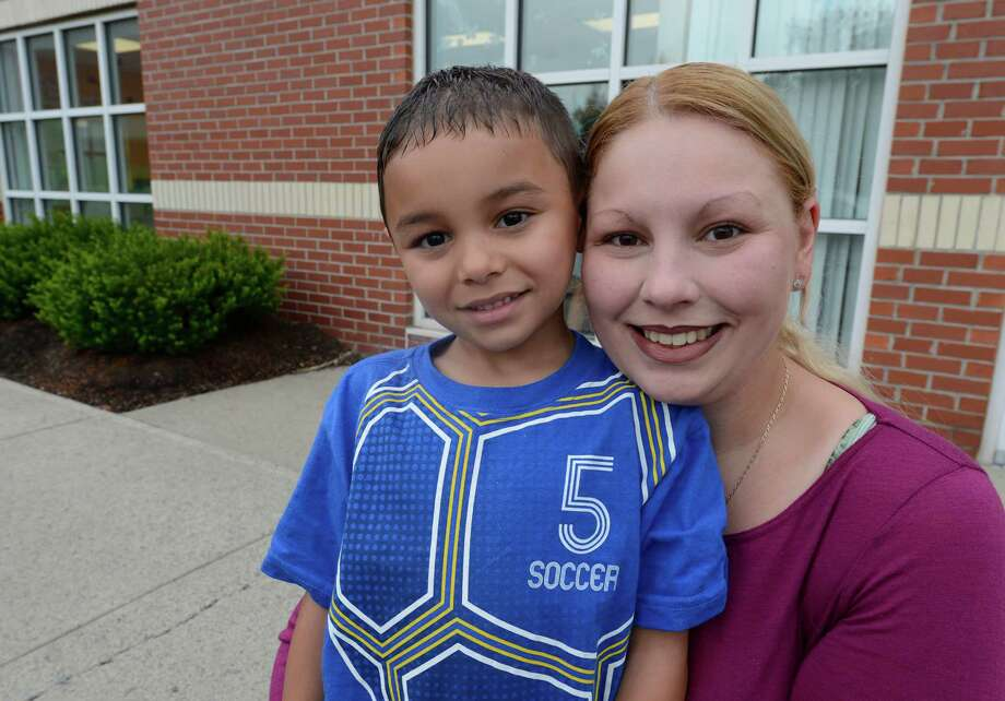 Dylan and Sandra Negron in Colonie, N.Y. July 18, 2012.  Sandra Negron is one of the parents upset about photos not delivered to members of the Clifton Park Soccer Club.   (Skip Dickstein / Times Union) Photo: SKIP DICKSTEIN / 00018501A