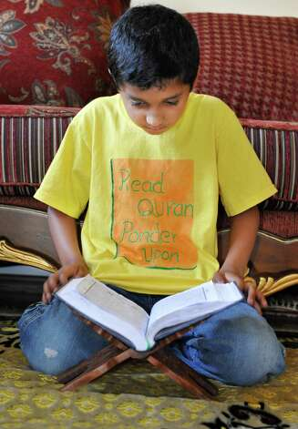 Fattah Ahmed, 9, memorizing and reciting the Koran at his Glenville home Wednesday July 18, 2012.   (John Carl D'Annibale / Times Union) Photo: John Carl D'Annibale / 00018493A
