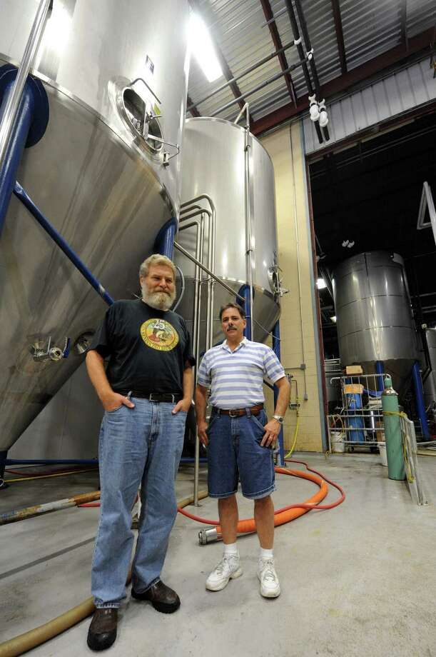 Olde Saratoga Brewing Co. brew master Paul McErlean, left, and general operations manager Keith Ricciardone at the brewery in Saratoga Springs NY Wednesday July 18, 2012. (Michael P. Farrell/Times Union) Photo: Michael P. Farrell