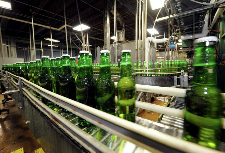 Kingfisher Premium Lager beer being bottled at Olde Saratoga Brewing Co. in Saratoga Springs NY Wednesday July 18, 2012. (Michael P. Farrell/Times Union) Photo: Michael P. Farrell