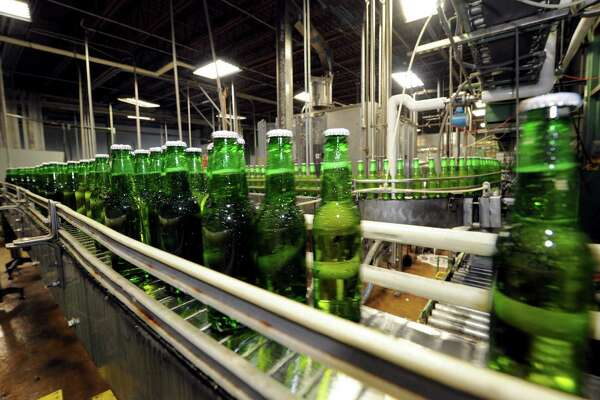 Kingfisher Premium Lager beer being bottled at Olde Saratoga Brewing Co. in Saratoga Springs NY Wednesday July 18, 2012. (Michael P. Farrell/Times Union)