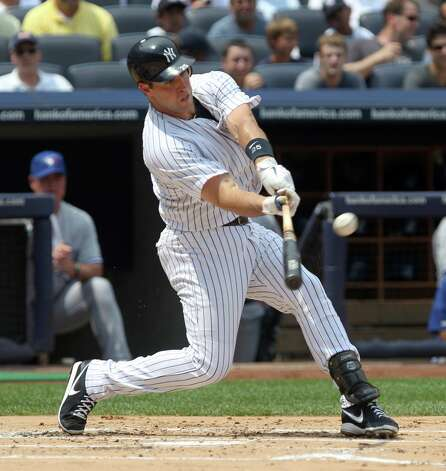 New York Yankees' Mark Teixeira hits a two-run homer during the first inning of a baseball game against the Toronto Blue Jays,  Wednesday, July 18, 2012 at Yankee Stadium in New York. (AP Photo/Seth Wenig). Photo: Seth Wenig