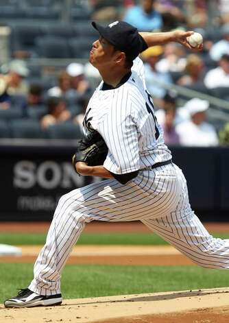 New York Yankees starting pitcher Hiroki Kuroda, of Japan,  pitches during the first inning of a baseball game against the Toronto Blue Jays Wednesday, July 18, 2012 at Yankee Stadium in New York. (AP Photo/Seth Wenig). Photo: Seth Wenig