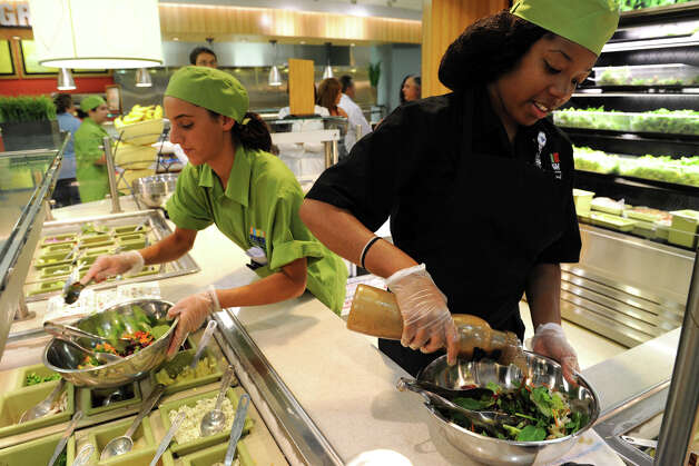 Tricia Yod and Khamaisa Bragg create made to order hand tossed salads for customers in the cafeteria at Bridgeport Hospital, in Bridgeport, Conn. July 12th, 2012. Photo: Ned Gerard