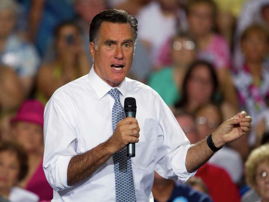 Republican presidential candidate, former Massachusetts Gov. Mitt Romney gestures during a campaign stop on Wednesday, July 18, 2012 in Bowling Green, Ohio.  (AP Photo/Evan Vucci) Photo: Evan Vucci
