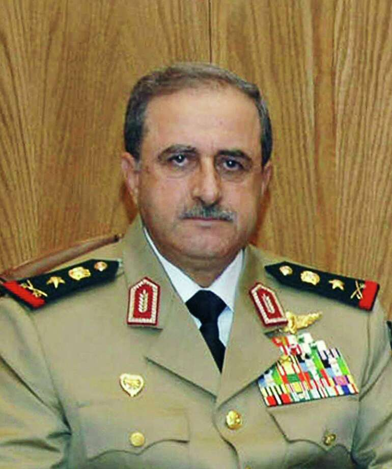 This undated photo released by the Syrian official news agency SANA, shows Syrian Defense Minister Gen. Dawoud Rajha in Damascus, Syria. Syria's state-run TV says the country's defense minister has been killed in a suicide blast in the capital Wednesday, July 18, 2012 in an attack that struck the National Security building in Damascus during a meeting of Cabinet ministers and senior security officials. (AP Photo/SANA) Photo: Anonymous