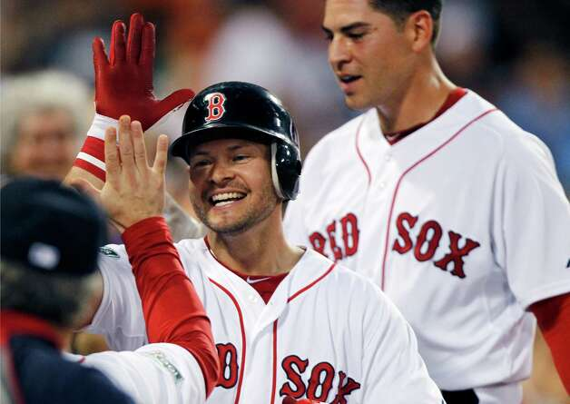 Boston Red Sox's Cody Ross, center, celebrates his three-run home run that also drove in Jacoby Ellsbury, right, in the third inning of a baseball game against the Chicago White Sox in Boston, Wednesday, July 18, 2012. (AP Photo/Michael Dwyer) Photo: Michael Dwyer