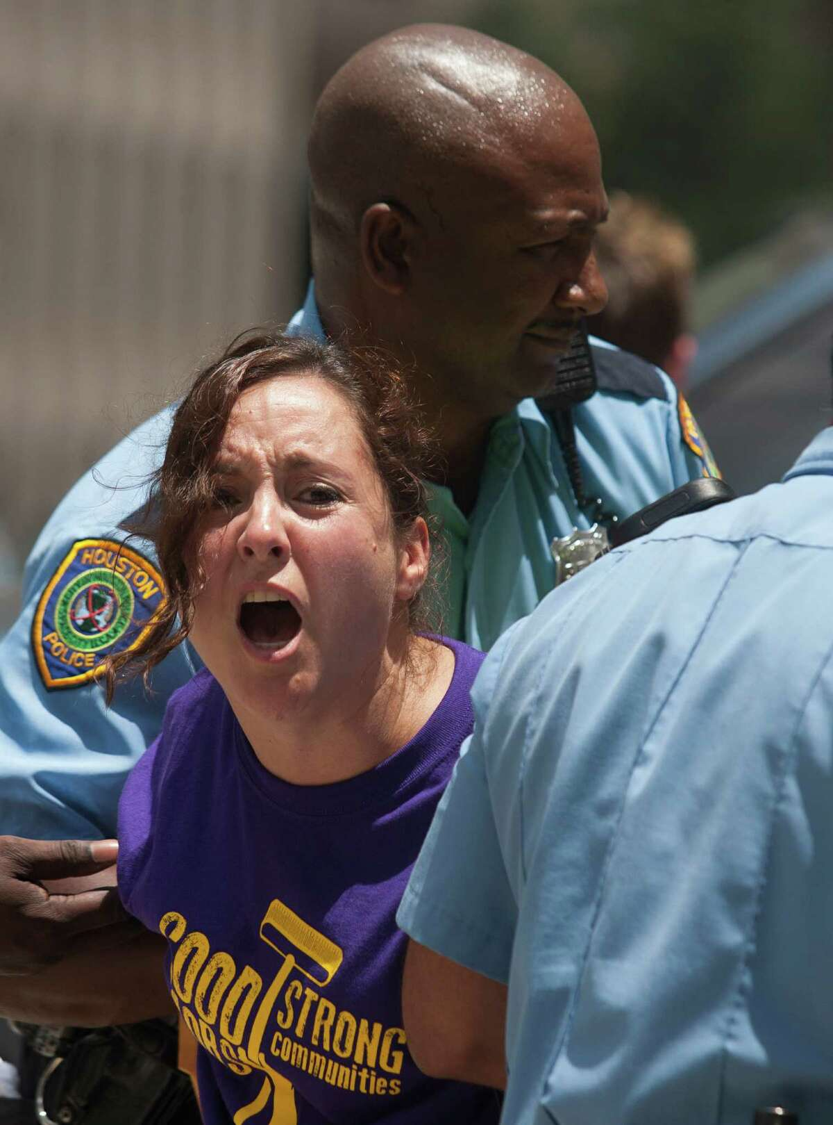 Police arrest a demonstrator on Wednesday in downtown Houston. A union spokeswoman called the civil disobedience a