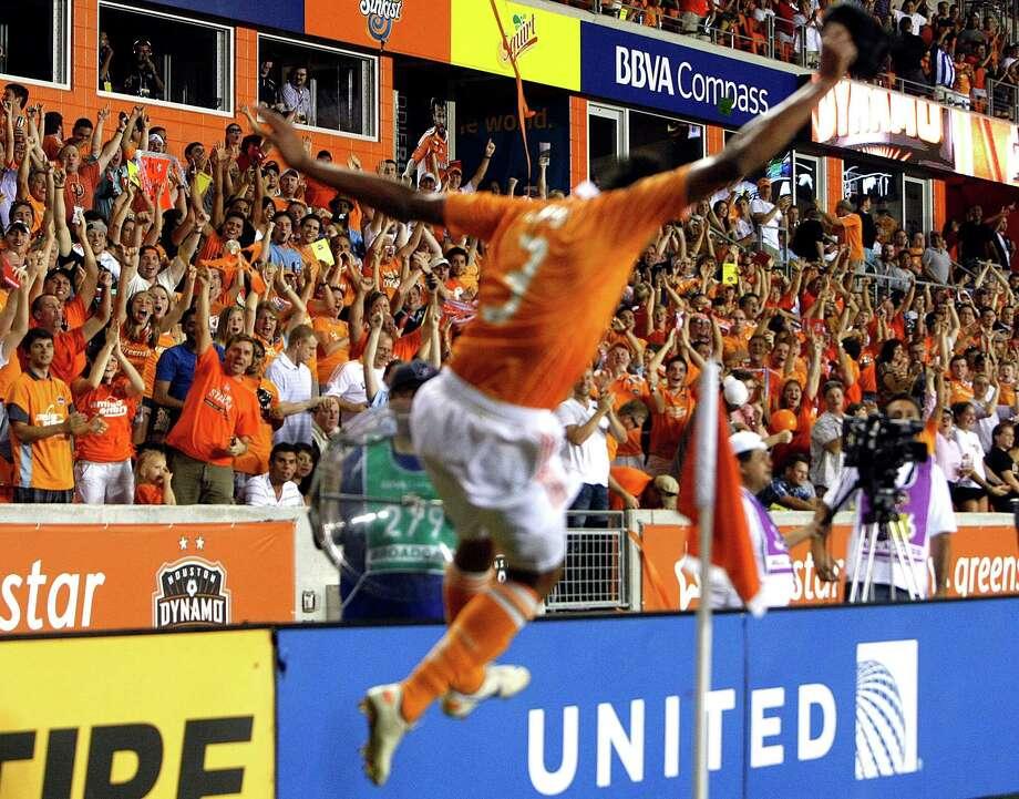 Houston Dynamo forward Calen Carr celebrates his game-winning goal.  Photo: Johnny Hanson, Houston Chronicle / © 2012  Houston Chronicle