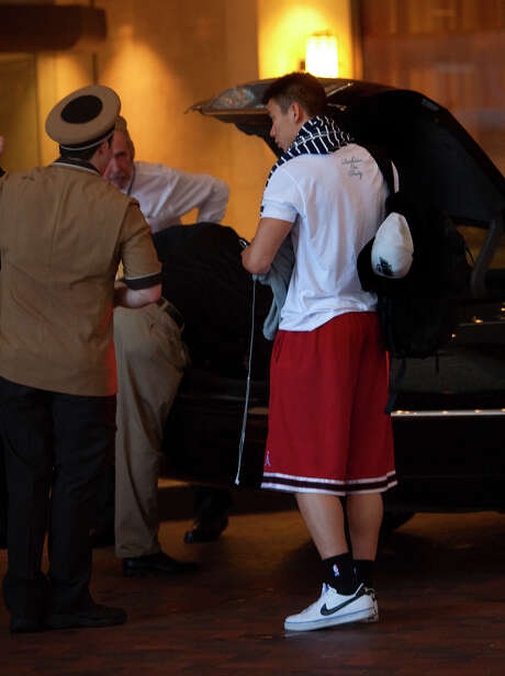 Jeremy Lin, shown arriving at the Four Seasons Hotel on Wednesday, will have to play even better than last season to keep the buzz over him going, experts say. Photo: Cody Duty / © 2011 Houston Chronicle
