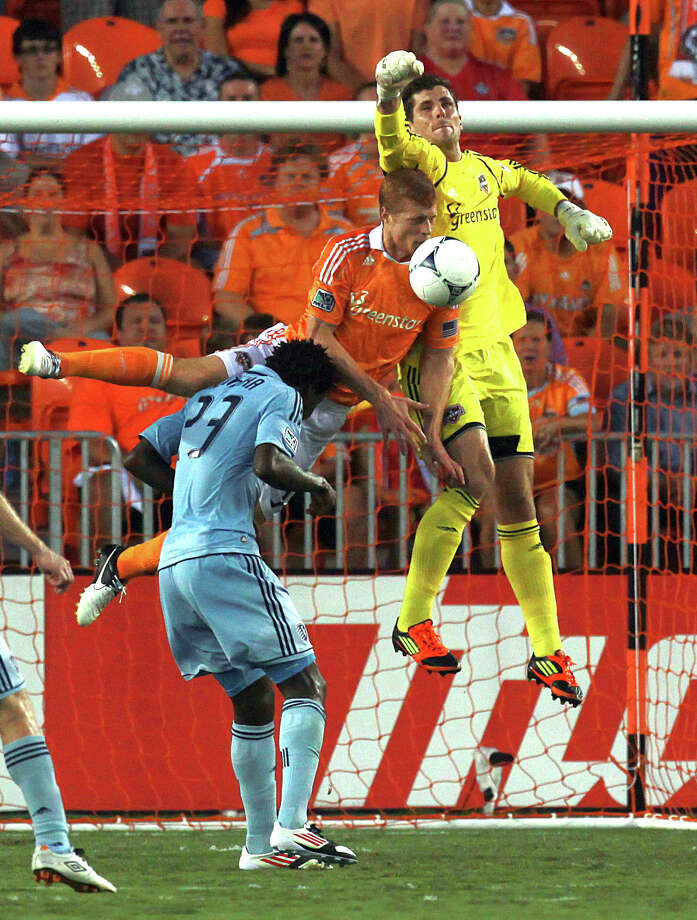 Houston Dynamo defender Andre Hainault (31) top left and Houston Dynamo goalkeeper Tally Hall (1) stop a shot attempt by Sporting KC forward Kei Kamara (23) in the first half as the Houston Dynamo played Sporting Kansas City at BBVA Compass Stadium in a MLS soccer match Wednesday, July 18, 2012, in Houston. ( Johnny Hanson / Houston Chronicle ) Photo: Johnny Hanson / © 2012  Houston Chronicle