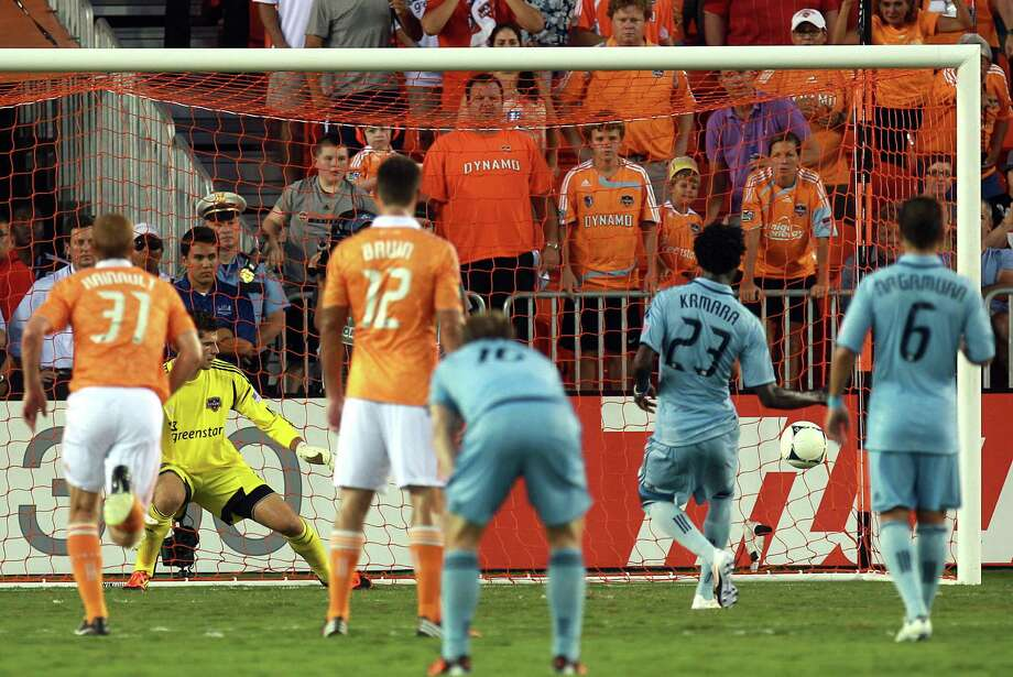Sporting KC forward Kei Kamara scores a goal on a penalty kick past goalkeeper Tally Hall. Photo: Johnny Hanson, Houston Chronicle / © 2012  Houston Chronicle
