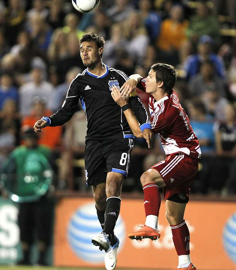 Earthquakes Chris Wondolowski, (8) heads the ball in front of Zach Lloyd, (17) in the first half, as the San Jose Earthquakes take on FC Dallas at Buck Shaw Stadium on Wednesday July 18.2012 in  Santa Clara, Ca. Photo: Michael Macor, The Chronicle