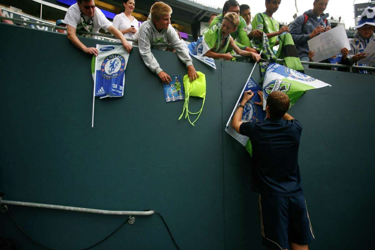 Chelsea keeper, Petr Cech, signs flags for fans at the Sounders vs. Chelsea game at CenturyLink field in Seattle on Wednesday, July 18, 2012. The Sounders were defeated 2-4.