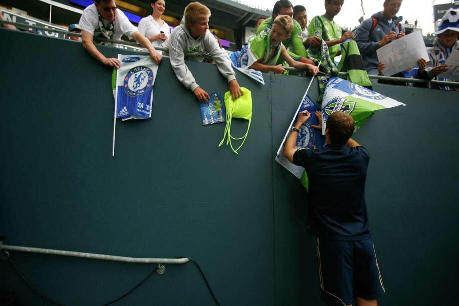 Chelsea keeper, Petr Cech, signs flags for fans at the Sounders vs. Chelsea game at CenturyLink field in Seattle on Wednesday, July 18, 2012. The Sounders were defeated 2-4. Photo: Sofia Jaramillo / SEATTLEPI.COM