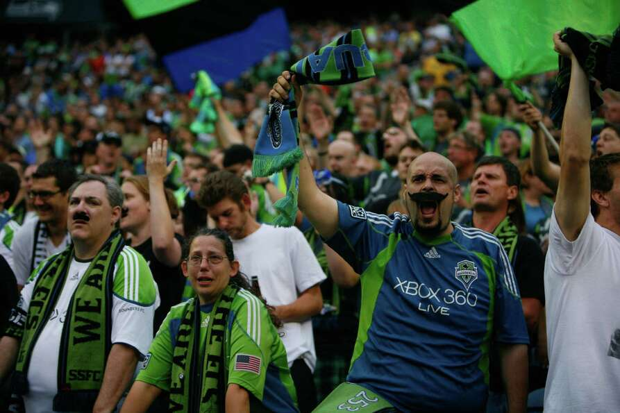 Fans cheer during the  Sounders vs. Chelsea game at CenturyLink field in Seattle on Wednesday, July