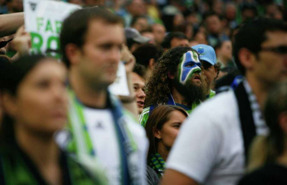 A fan is shown with a painted face during the  Sounders vs. Chelsea game at CenturyLink field in Seattle on Wednesday, July 18, 2012. The Sounders were defeated 2-4. Photo: Sofia Jaramillo / SEATTLEPI.COM