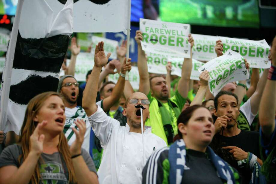 Fans wear fake mustaches during the  Sounders vs. Chelsea game at CenturyLink field in Seattle on Wednesday, July 18, 2012. The Sounders were defeated 2-4. Photo: Sofia Jaramillo / SEATTLEPI.COM