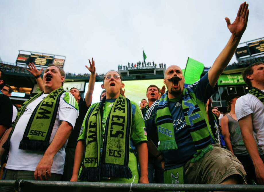 Fans cheer during the  Sounders vs. Chelsea game at CenturyLink field in Seattle on Wednesday, July 18, 2012. The Sounders were defeated 2-4. Photo: Sofia Jaramillo / SEATTLEPI.COM