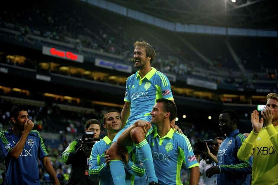 Sounders player, Roger Levesque, is held up by players after the Sounders vs. Chelsea game at CenturyLink field in Seattle on Wednesday, July 18, 2012. This was Roger Levesque's last game with the sounders. The Sounders were defeated 2-4. Photo: Sofia Jaramillo / SEATTLEPI.COM