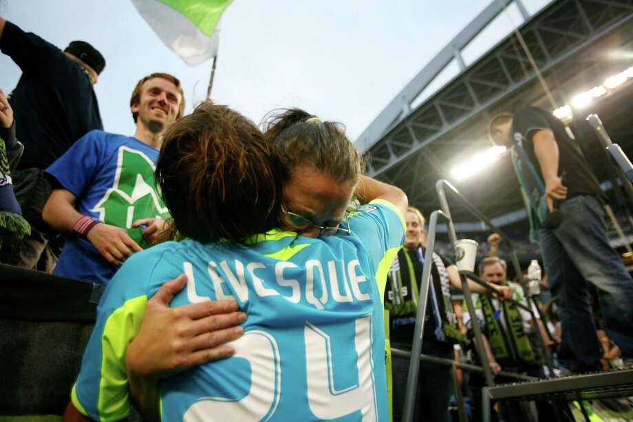 Sounders player, Roger Levesque, gives a fan a hug after the Sounders vs. Chelsea game at CenturyLink field in Seattle on Wednesday, July 18, 2012. This was Roger Levesque's last game with the sounders. The Sounders were defeated 2-4. Photo: Sofia Jaramillo / SEATTLEPI.COM