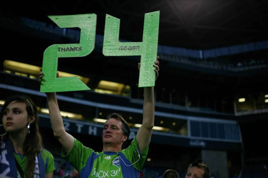 A fan is shown with a sign after the Sounders vs. Chelsea game at CenturyLink field in Seattle on Wednesday, July 18, 2012. The Sounders were defeated 2-4. Photo: Sofia Jaramillo / SEATTLEPI.COM