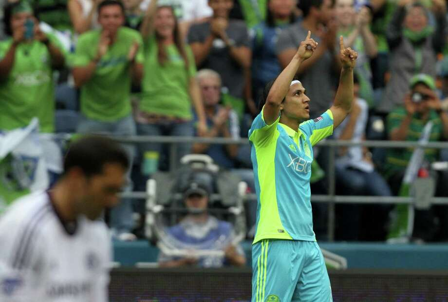 Sounders forward, Fredy Montery, celebrates after scoring a goal during the first half of the Sounders vs. Chelsea game at CenturyLink field in Seattle on Wednesday, July 18, 2012. The Sounders were defeated 2-4. Photo: Sofia Jaramillo / SEATTLEPI.COM