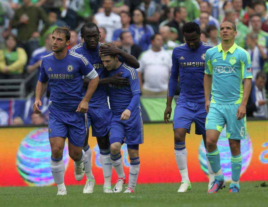Chelsea midfielder, Marko Marin, is congradulated by teammates after scoring a goal during the Sounders vs. Chelsea game at CenturyLink field in Seattle on Wednesday, July 18, 2012. The Sounders were defeated 2-4. Photo: Sofia Jaramillo / SEATTLEPI.COM