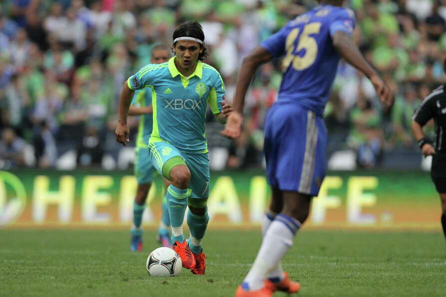 Sounders forward, Fredy Montery, dribbles the ball during the Sounders vs. Chelsea game at CenturyLi